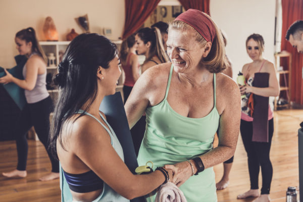 women sociallizing in Power Yoga Canada Studio