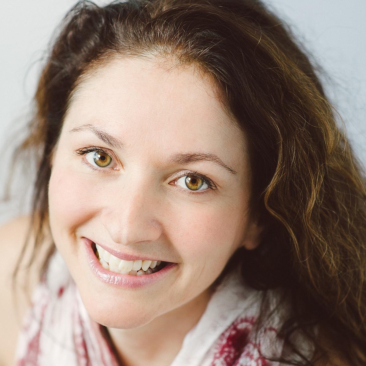 Kinndli, the Power Yoga Canada Instructor, smiling