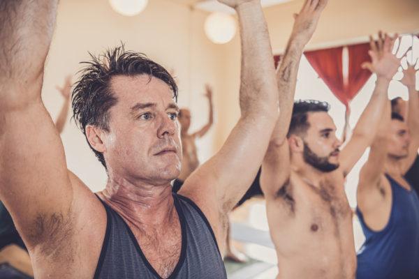 men doing yoga at Power Yoga Canada studio